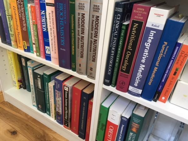 Image: nutrition books on bookshelf.